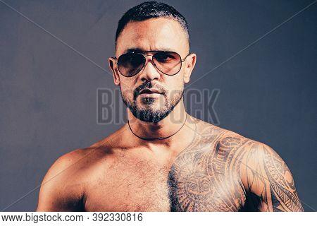 Sungalass Male Portrait. Mans Fashions Sungalass. Handsome Man Closeup Portrait. Stylish Latin Man.