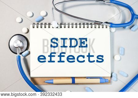 Side Effects, Text On White Paper On Notepad On Gray Background