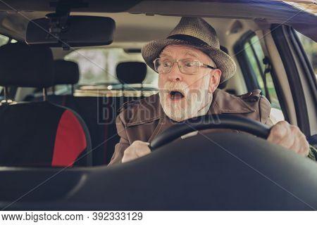 Photo Of Retired Old Man Surprised Face Open Mouth Drive Wear Brown Jacket Headwear Eyewear Inside C