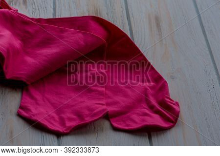 Pink Tights On Wood Background. Pink Tights As A Female Element Of Clothing. Clothes