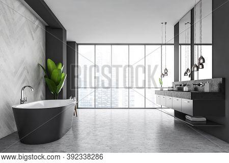 Grey Bathroom With Grey Bathtub And Sinks, Pendant Lamps. Bathroom With A Tall Windows On The City V
