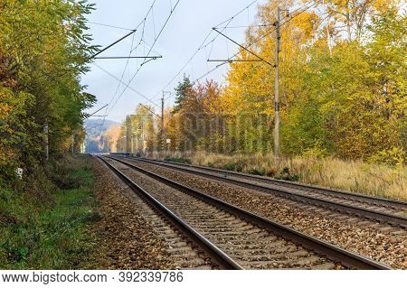 Railway Tracks. Rail Transport. Train Transport. Autumn Foggy Morning. Rural Landscape With Railway