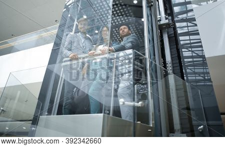 Business team group going on elevator.