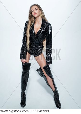 Sexy Woman Legs In High Black Boots. Latex Leather Fashion. Full Length Sexy Young Woman. Womans Sho