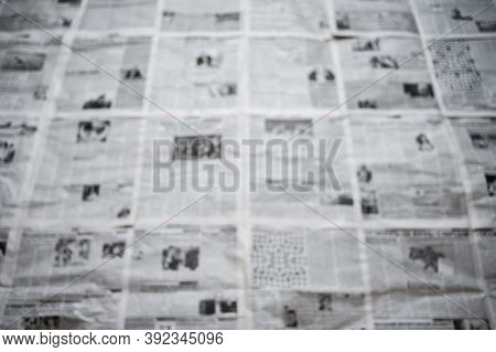 A Lot Of Newspapers On A Horizontal Surface. Background Texture, Blurry. Concept For News And Inform