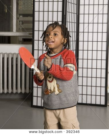Kid Playing With A Paddle