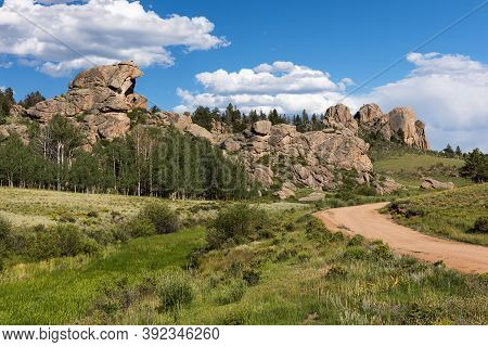 A County Road Passes By Dramatic Rock Formations In Castle Rock Park In Central Colorado.\ncastle Pa