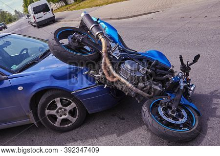 Damaged In A Accident Motorbike And A Car