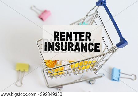 Business Concept. In The Shopping Cart, The Text Is Written On The Card - Renter Insurance.