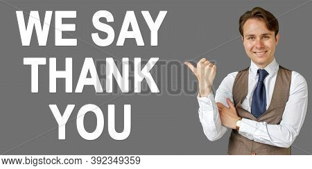 Emotional Portrait Of Businessman Showing Right Hand Gesture On Text - We Say Thank You. Gray Backgr