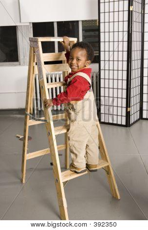 Baby Climbing A Ladder