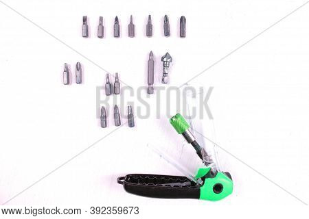 A Magnetic Quick Release Bit Holder With Various Screw Driving Bits And A Countersink. White Backgro