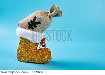 Christmas Shoe With A Rmb Money Bag On Blue