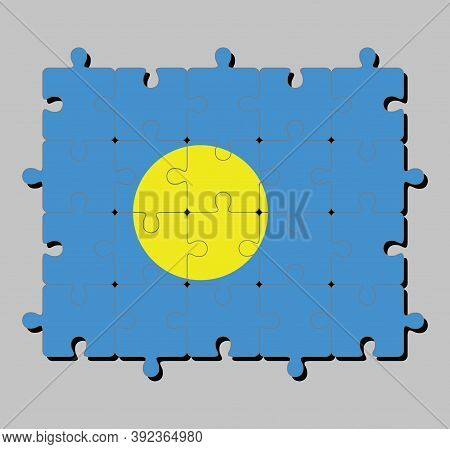 Jigsaw Puzzle Of Palau Flag In Light Blue Field With The Large Yellow Disk Shifted Slightly To The H