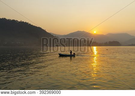 Sunrise In The Morning And Silhouette Small Boat At Koh Chang Thailand. Koh Chang Is Located In The