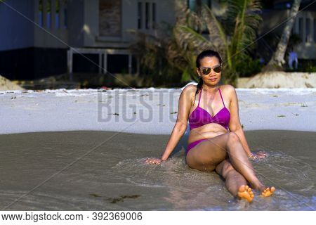 Woman With Bikini Sit Relax On Beach At Beach Koh Chang Thailand. Koh Chang Is Located In The Easter