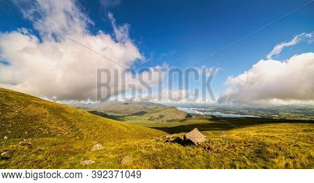 Panoramic View Of Lough Leane With Ross Island In Horizon And The Slopes Of Mount Mangerton With A L