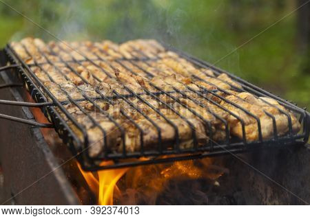 Grilled Chicken On The Grill. Processcooking Chicken Legs On A Barbecue Grill Outdoorsflames And Smo