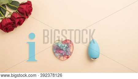 Rose Heart And Clitoral Vibrator On A Beige Background. Flat Lay