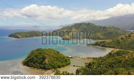 Aerial View Of Sleeping Dinosaur Island Of Mati Davao Oriental Philippines. One Of The Known Tourist