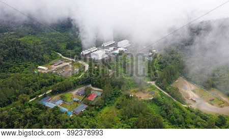 Geotermal Power Plant On Mount Apo. Geothermal Station With Steam And Pipes In The Rainforest. Minda