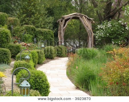 Nice and pretty wooden arch in a garden poster