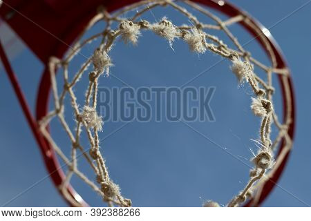 Basketball Hoop Ring Close-up Bottom View With Sky Background, Copy Space.