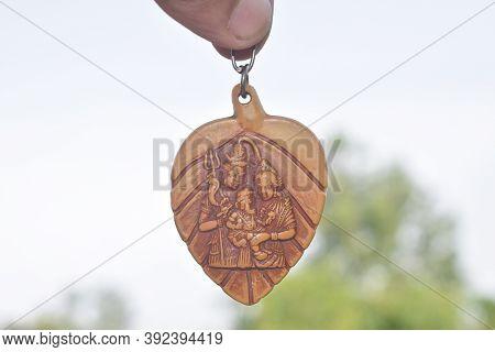 Holy Shiva Parbati And Ganesh Keyring On White Background
