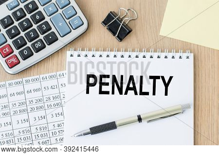 Penalty Text On Open White Notepad On The Desktop. Business Photo Text