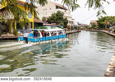 Malacca, Malaysia, October 31, 2020: Melaka River Cruise Offer Tourist A Glimpse Of Historic City Wi