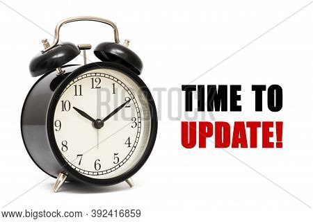 Alarm Clock And Text Time To Update.  Time To Update Concept. Time To Update Concept Clock Closeup O