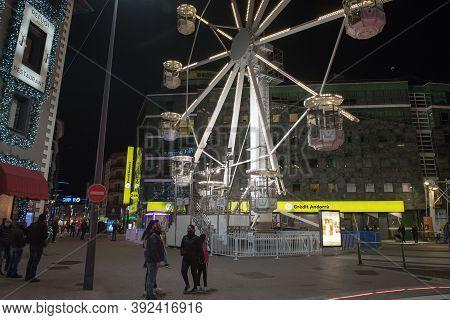 Andorra La Vella, Andorra : 2020 October 30 : People Walk In The Steet Behind The Ferris Wheel In Th