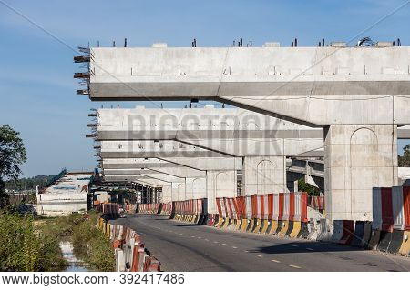 Construction Of Highway Overpass Bridge And Rail Transit Infrastructure In Progress With Morning Sun