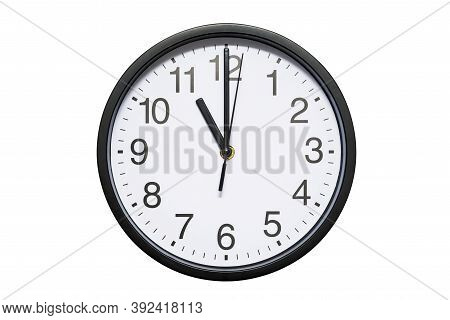 Wall Clock Shows Time 11 O'clock On White Isolated Background. Round Wall Clock - Front View. Eleven