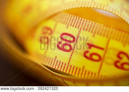 Various Tape Measure As Background. A Yellow Measuring Tape As Background. Measuring Tape Of Yellow