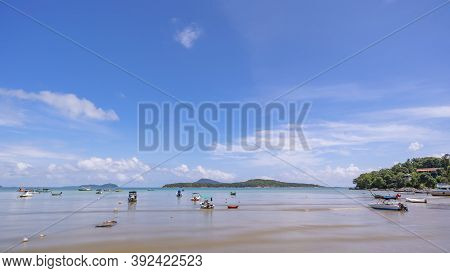 Tropical Beach With Longtail Boats In The Sea Blue Sky And White Clouds In Summer Season