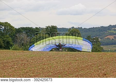 Paramotor Trike Launching Wing In A Field