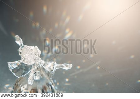 Crystal Glass Angel In The Rays Of The Sun With Reflecting, Embossed Sparkle. Faith, Hope, Mercy Con