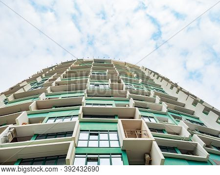 Russia, Sochi 18.02.2020. Green High-rise Building With White Ledges Against The Background Of A Clo