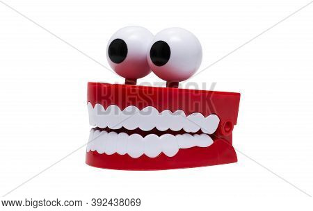 Mouth Toy, Isolated On White Background. Chattering Teeth On White Background