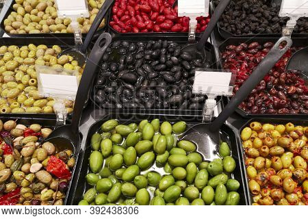 Variety Assortment Diverse Of Healthy Tasty Green And Black Olives In Black Plastic Bowls For Sale O