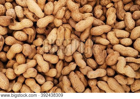 Peanuts In Shell Texture Background. Raw Peanuts On Display At A Farmer's Market. Unpeeled Peanut Ba