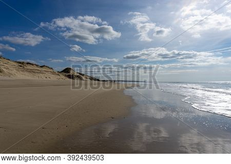 Wide Empty Beach And Sand Dunes On The Atlantic Ocean Coast In France