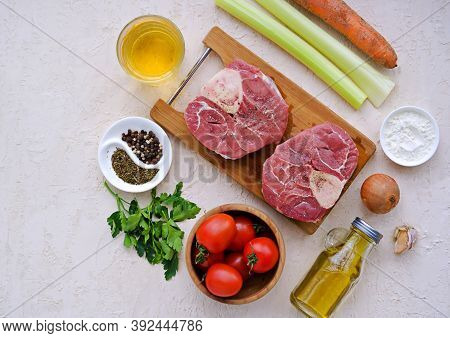Ingredients For Ossobuco, Beef Shank Stew On A Bone With Carrots, Tomatoes And Celery On A Light Con