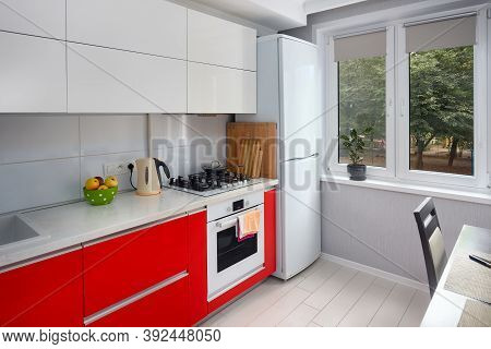 Upscale Maple Red And Smoky White Kitchen In Luxury Home With Stoneware Countertop Flat Wooden Panel