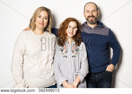 A Beautiful Happy Family Together On Studio White Background