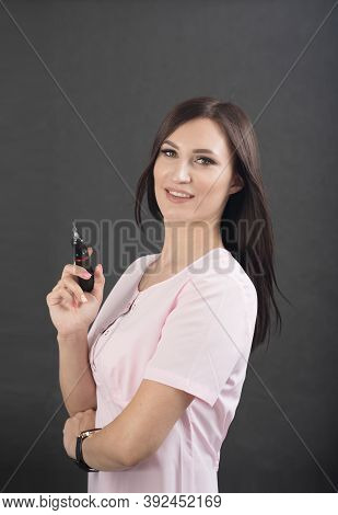 Cosmetologist Making Permanent Makeup, Girl Beautician Holding A Tool In Her Hands, Permanent Makeup