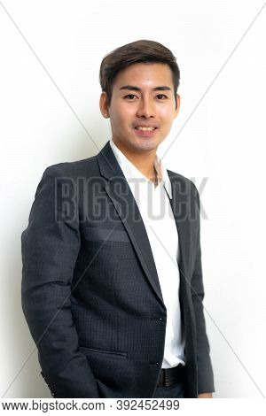 Portrait Of Asian Businessman Isolated On White Background.