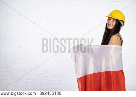 A Teenager Wearing A Protective Helmet Threw On Her Shoulders And Back The National Symbol Of Poland