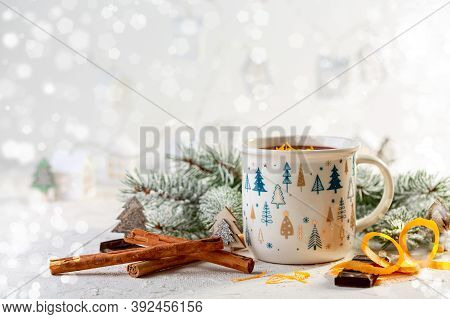 Cozy Winter Composition With A Cup Of Hot Chocolate And Snow-covered Branches On A Bright Festive Ba